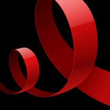 Red fabric glossy curved ribbon on black Royalty Free Stock Photo