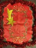 Red fabric and yellow christmas star royalty free stock photography