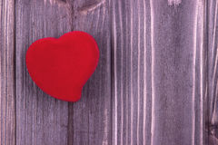 Red fabric Heart on the dark wooden background. Valentine Day.Wedding.Geeting card. Stock Photos