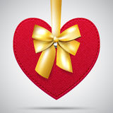Red fabric heart with golden ribbon Royalty Free Stock Photo
