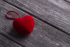 Red fabric Heart on the gray wooden background. Valentine Day. Wedding. Stock Images