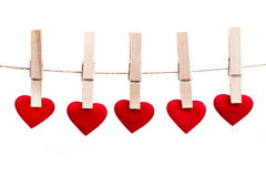Red fabric heart hanging on the clothesline Stock Images