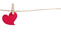 Red fabric heart hanging on the clothesline royalty free stock photos