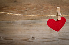 Red Fabric Heart Hanging On The Clothesline Royalty Free Stock Photo