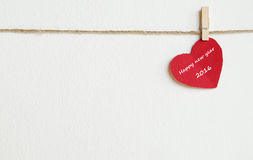 Red fabric heart with happy new year 2016 word hanging on the cl Stock Photo