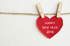 Red fabric heart with happy new year 2016 word hanging on the cl Royalty Free Stock Photos