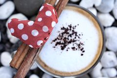 Red fabric heart with hot cappuccino Royalty Free Stock Photo