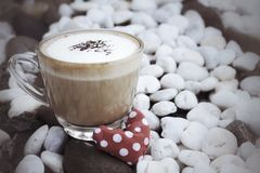 Red fabric heart with hot cappuccino Stock Photography