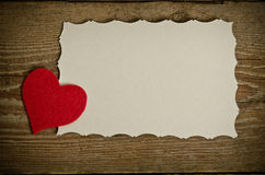 Red fabric heart with piece of paper Royalty Free Stock Photo