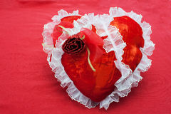 Red fabric heart on a red background Royalty Free Stock Photo