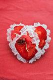 Red fabric heart on a red background Royalty Free Stock Image