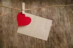 Red fabric heart with sheet of paper Royalty Free Stock Photo