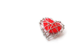 Red fabric heart in wire Stock Image