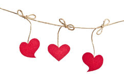 Red fabric hearts hanging on the clothesline Royalty Free Stock Photo