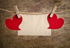 Red fabric hearts with sheet of paper Stock Photos
