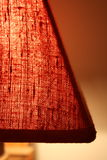 Red fabric of a lampshade. Close shot of the red fabric of a lampshade Stock Photography