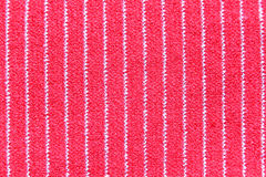 Red fabric in macro style. Stock Image