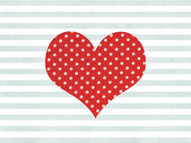 Red fabric polka dot heart on watercolor blue stripes background. Stock Images