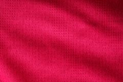 Red fabric sport clothing football jersey with air mesh texture Stock Image