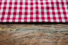 Red fabric tablecloth textile on wooden Stock Photo