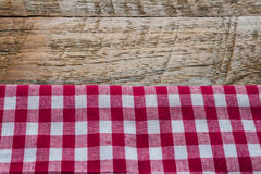 Red fabric tablecloth textile on wooden Royalty Free Stock Photos