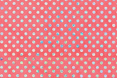 Red fabric texture with bright circles. Top view Royalty Free Stock Images