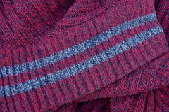 Red fabric texture with gray stripes on the collar. Of woolen clothes Stock Image