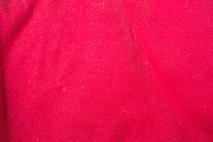 Red fabric texture with doghair and spots stock photography