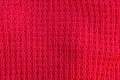 Red fabric texture from a piece of wool stock photography