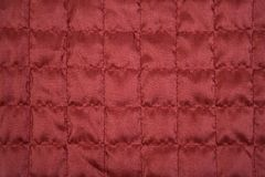 Red fabric texture with sewing square pattern Stock Photo