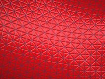 Red fabric with triangle stitched pattern. Useful as background Royalty Free Stock Image