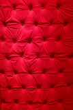 Red fabric upholstery. Pattern of a furniture upholstery tapestry texture. Red color Stock Photos