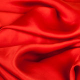 Red fabric on a white background. Studio shot royalty free stock photos