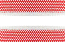 Red fabric with white dots and lace Stock Images