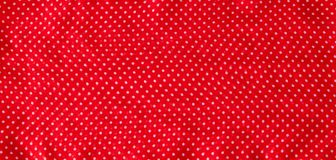 Red fabric with the white polka dots as a background texture composition royalty free stock image