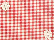 Red fabric wih floral in the corner as background Stock Photography