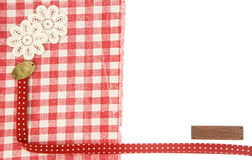 Red fabric wih floral and wood tag as background Royalty Free Stock Photo