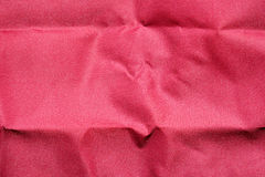 Red fabric wrinkled texture background. Royalty Free Stock Photography