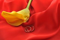 Red  fabric and  yellow flower Royalty Free Stock Photography