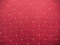 Red fabric with yellow tips Stock Photos