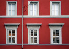 Red facade building. Detail of a red facade building with six windows Stock Images