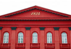 Red facade of Kiev National University with semicircular white windows. The red facade of the Kiev National University of Taras Shevchenko. Semicircular white Stock Images