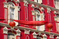 Red facade and red Chinees lantern. Stock Image