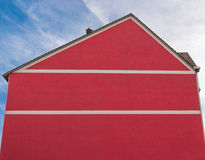 Red facade and sky. Red facade and blue sky royalty free stock image