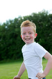 Red face. Young boy running with a red face Stock Images