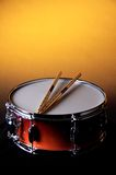 Red Fade Snare Drum. A red fade snare drum isolated against a gold or yellow background in the vertical or portrait view Stock Photography