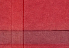 Red faded fabric background. With creases stock image