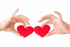 Red fake heart on couple hands Royalty Free Stock Images