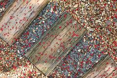 Red fall pollen scattered on the gravel and stone blocks. Selective focus. Pollen red fall spread on the area is gravel and floor stone blocks. Selective focus stock images