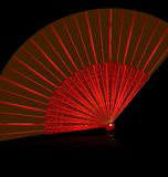 Red fan. Black background and the red golden fan Royalty Free Stock Images